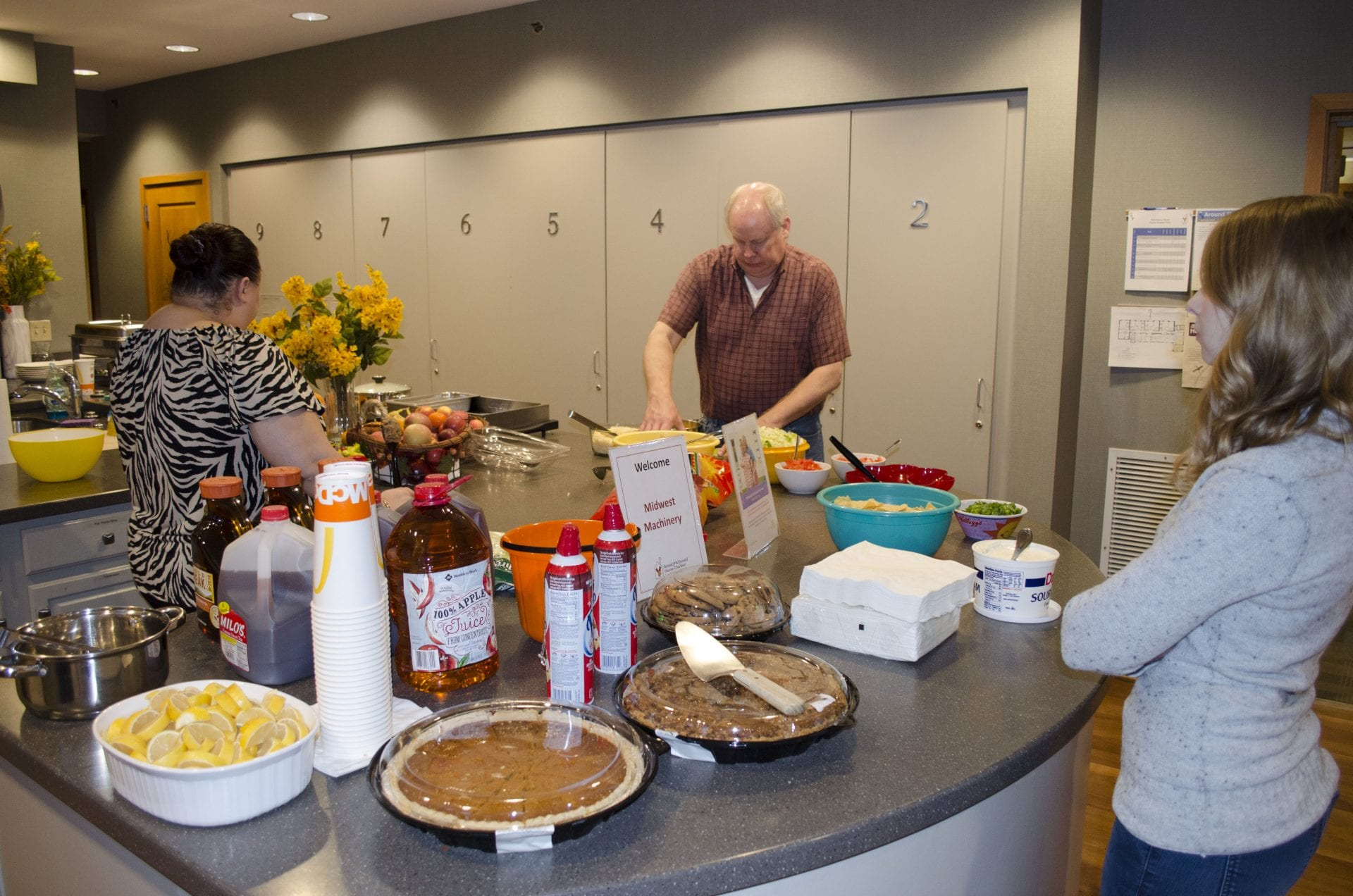 Midwest Machinery Team Works Together To Prepare Dinner At